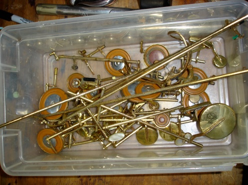 Box of saxophone keys.  Dirty, dirty saxophone keys.